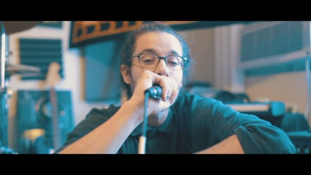 Matt Rich with microphone in the sauna